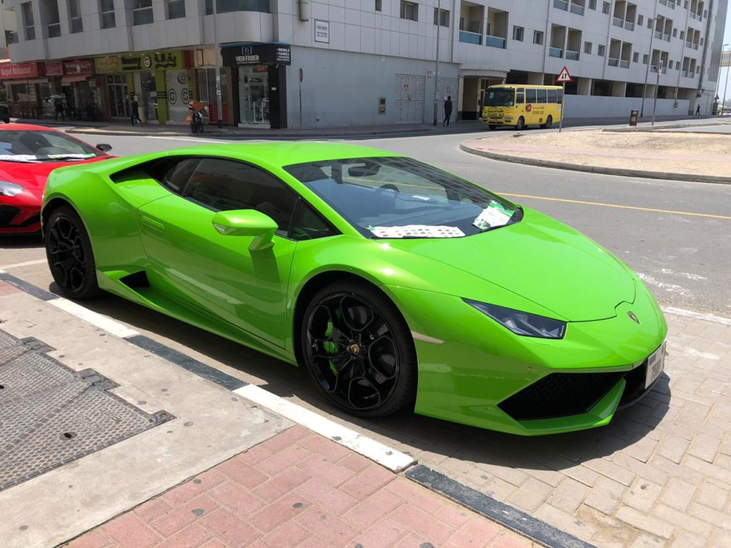 Green lamborghini huracan exterior for rent dubai UAE Overdrive rent a car