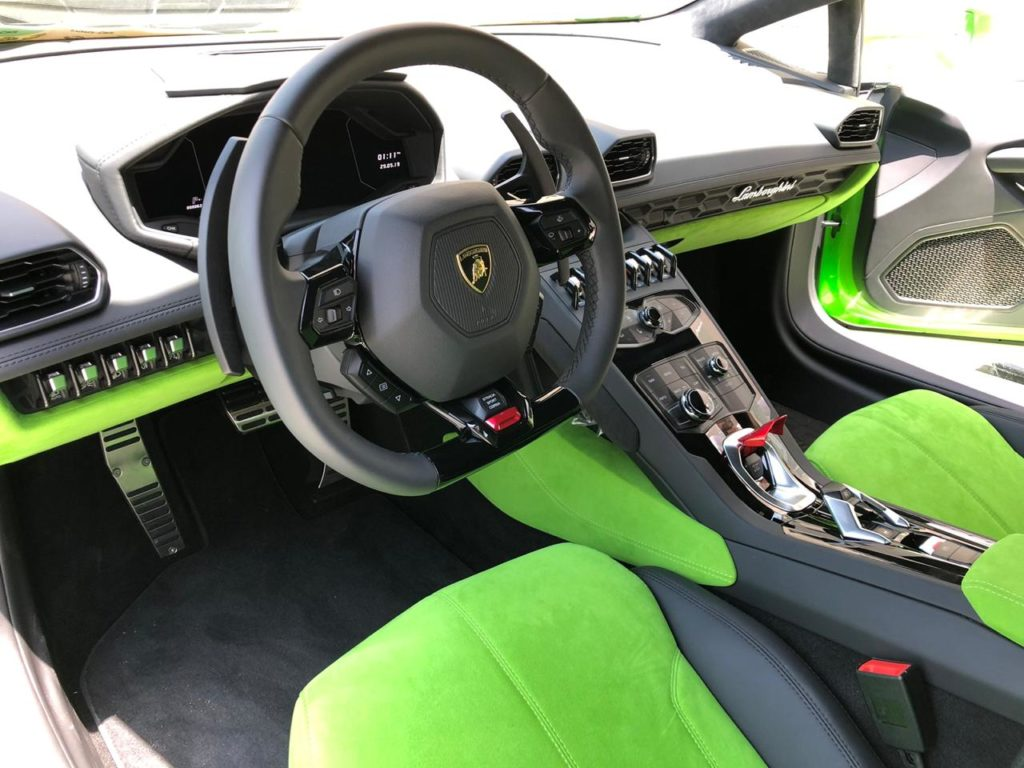Green lamborghini huracan interior for rent dubai UAE Overdrive rent a car