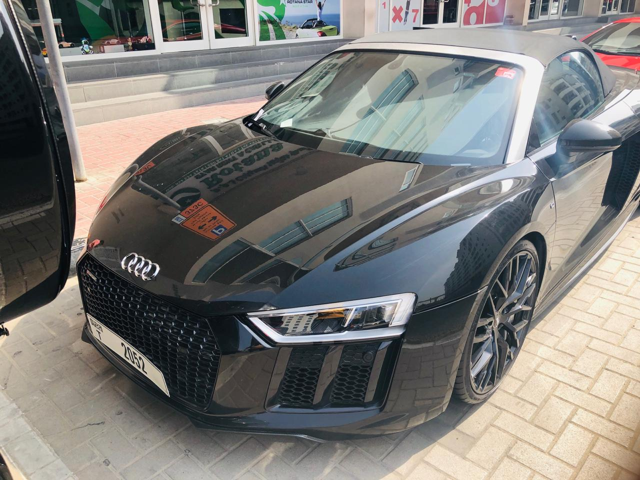 Exterior black soft top convertible audi r8 for rent Dubai UAE overdrive rent a car